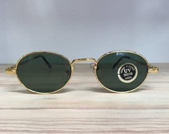 Gold oval vintage sunglasses greenish gray lens