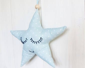 Star fabric blue sky and white hanging stars.