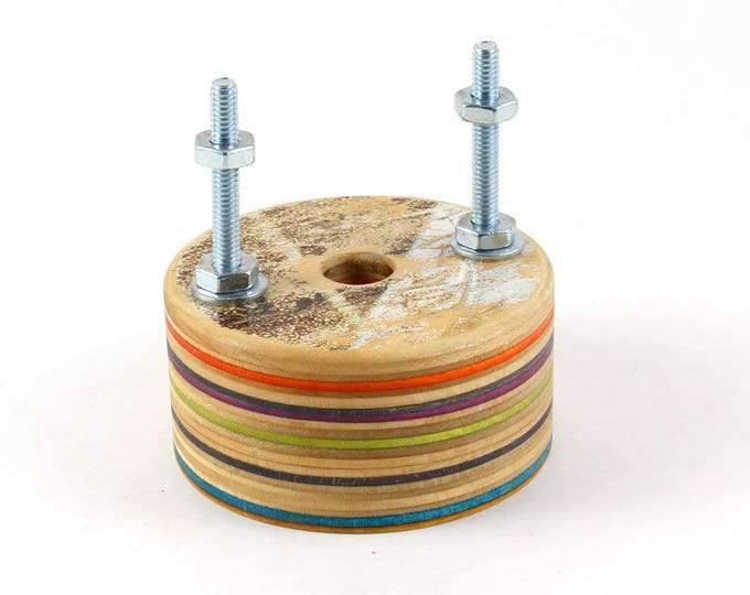 Floating Skateboard Wall Display Hanger made from recycled skateboards.