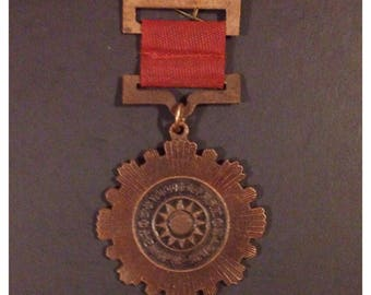 Old china military medal dated 1942 on back