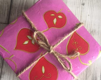 hand decorated gift box containing 2 natural heart shaped soaps