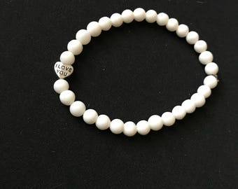 """6mm alabaster bead bracelet with """"i love you"""" and """"kiss me"""" charm"""