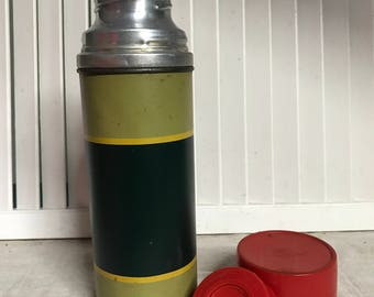 Here is a 1950s Aladdin Industries Vacuum Brand, Pint 16 oz. Size Thermos, Glass Lining, Aluminum Green Lime and Yellow