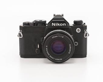Nikon FM 35mm film camera with 50mm 1.8 Nikon Series E prime lens and 1 pack film - great working manual camera a great student camera