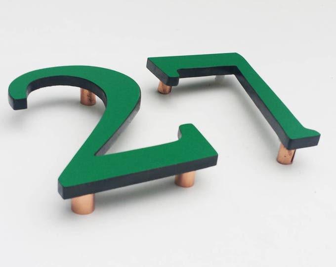 "Serif Coloured House floating numbers,  4""/100mm high in Garamond font,  standoff floating in resin board g"