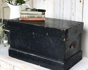 A fantastic chippy painted black engineer's trunk