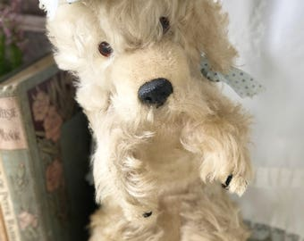 A lovely musical blonde Chiltern poodle plush toy