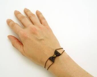 Bracelet with small bow tie