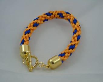 """Blue and Orange 6""""  Kumihimo Bracelet."""
