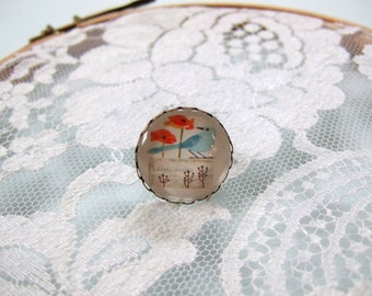 Bird and red flowers round cabochon ring