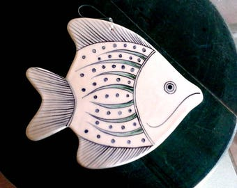 A fish shaped ceramic dish, hand painted