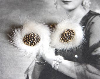 A pair of vintage clip earrings with fur detail.