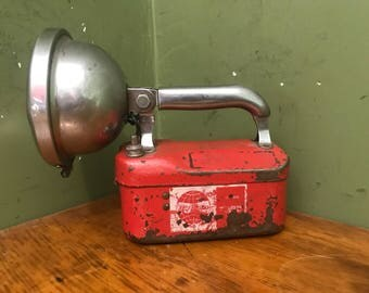 vintage red metal flashlight