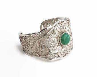 Wide sterling silver filigree cuff bracelet with green Chrysoprase cabochon in fancy bezel setting, handmade, 42 grams, circa 1970s
