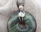 Labradorite pendant on black cord sterling silver wire wrap design.handmade silver jewellery.