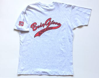 Vintage body glove athletics script spell out Short Sleeve T Shirt 100% cotton size XL Tail sweep spell out