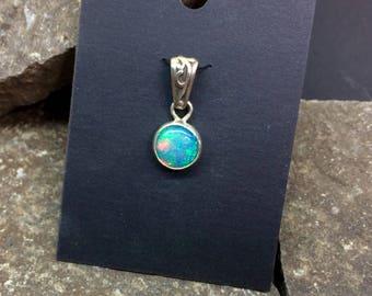 Opal pendant , fine silver