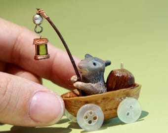 Tiny little mouse in a nutshell, bringing home its nut, holding a lantern