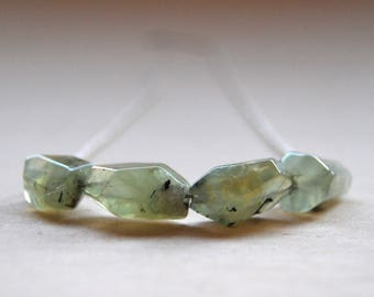 Silver long necklace Prehnite with gems.