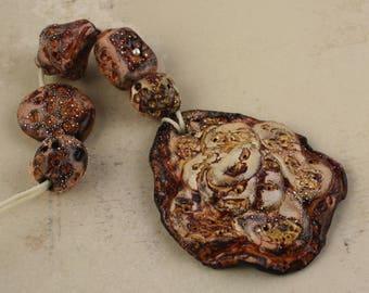 "Set of 5 handmade metallic ceramic glazed art beads and pendant focal and  including pendant  set""a rose"""