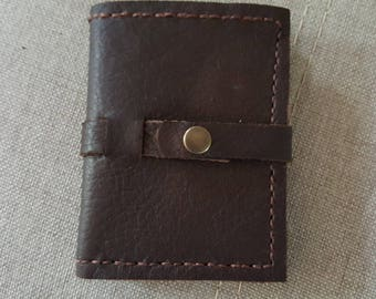 Snap closure brown leather wallet