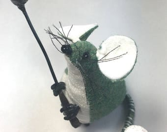 Small green mouse soft sculpture with golf club and ball