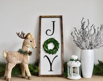 Joy farmhouse sign with preserved boxwood wreath and holly berries