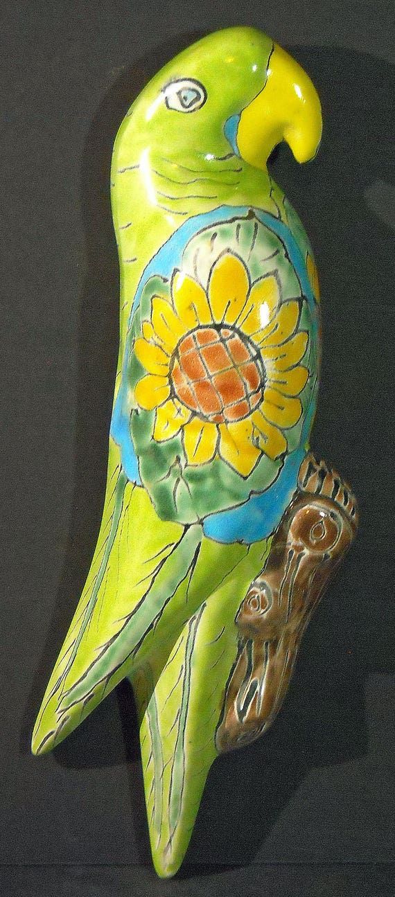 Rare and beautiful decorative genuine Mexican Folk Art Talvera Pottery Stylized Wall Macaw with Sunflower
