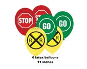 railroad party balloons, train birthday decorations, traffic signs, crossing sign, stop, go, primary colors, choo choo, engine