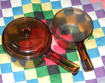 Two pans (1960-1970's) made of thick glass, Two cooking pots in glass. VINTAGE