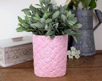 Vintage pink embossed ceramic vase