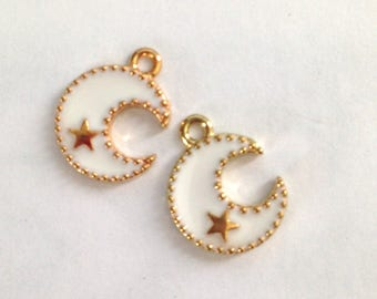 2 white enameled Moon charms and goldtone 17x13mm