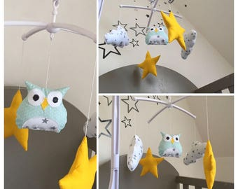 Mobile musical baby OWL with green water, clouds and stars