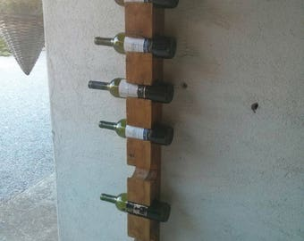 Wall wine rack for eight bottles