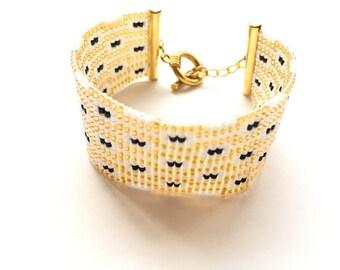 Very nice bracelet gold, black and white woven miyuki beads