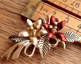 Vintage Brooch.Very attractive. Floral/Leafy Design. Nice Floral Clusters and defined leaves.