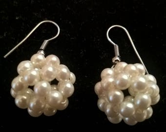 Vintage earrings, dangling with small cream colored beads