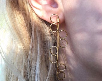Gold plated earrings. Unique modern minimalist shape. Handmade with one wire. Free delivery