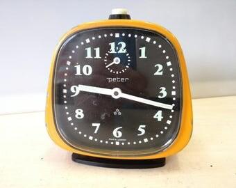Peter windup yellow alarm clock