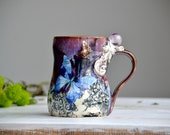 Fluorite sphere black flowers and butterflies with purple drippy glaze tall crystal mug