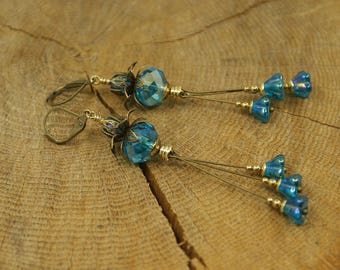 Dangling earrings, turquoise blue Crystal and brass