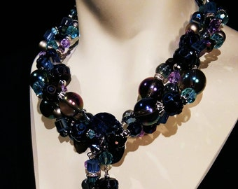 Big and bold choker, statement necklace multi blue, aqua,lavender glass and crysal beads on Abalone centerpiece Very Chic