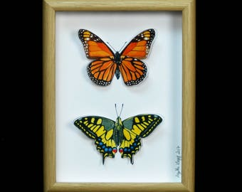 butterflies painted with watercolors and cut
