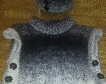 Handmade knitted baby's vest and hat