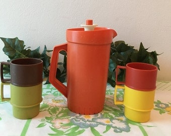 A Vintage 1970's Tuppertoy Pitcher and Cups Set
