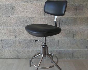 Top metal and chrome shop stool