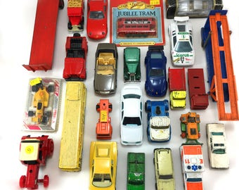 Die-cast collection 25 vehicles, some vintage.