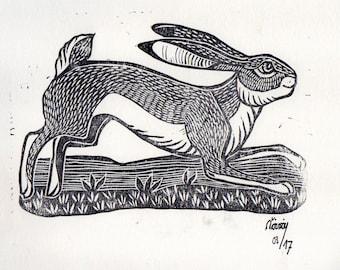Linocut of a running Hare