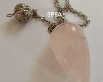 Pendulum dowsing in rose quartz, stone of love