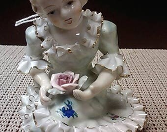 Girl holding a rose a Bone China Lace figurine from early 1900s in Japan